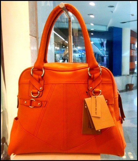 Orange leather handbag, ambience mall, ffordable luxury