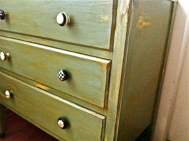 Antique dresser, refinished in green and crier color with horn and bone knobs from Anthropologie.com